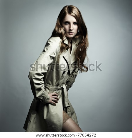 Fashion portrait of young beautiful woman in the raincoat - stock photo