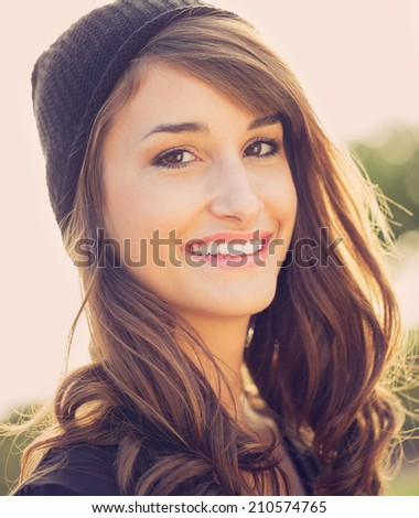 Fashion portrait of young beautiful woman outside, bright warm sunny color tones