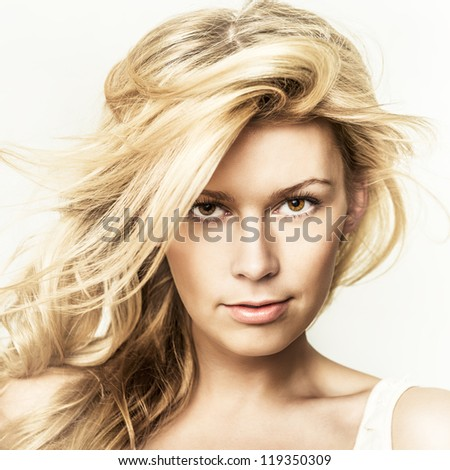 Fashion portrait of young beautiful woman  posing in studio - stock photo