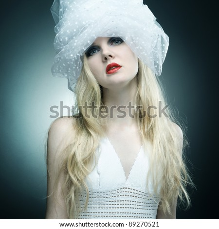 Fashion portrait of young beautiful woman with blond hair and bright makeup.
