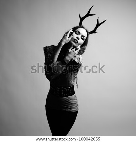 Fashion portrait of young beautiful woman with horn - stock photo