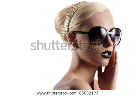 fashion portrait of young beauty woman with sunglasses and black lips looking surprised