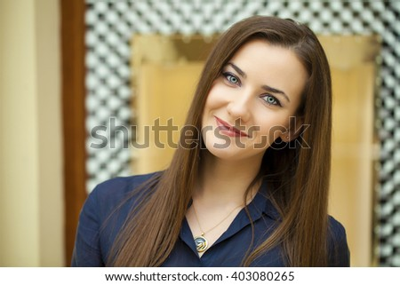 Fashion portrait of young brunette model posing in shop - stock photo