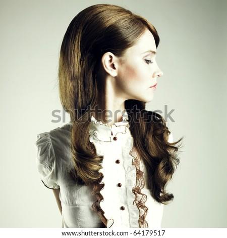Fashion portrait of young elegant brunette girl - stock photo