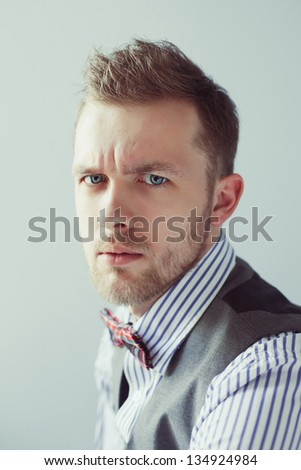 Fashion portrait of young gentleman in bowtie