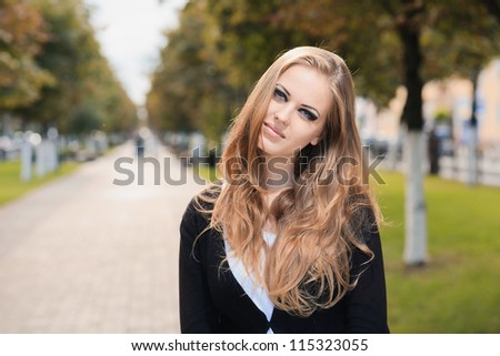 Fashion portrait of young gorgeous blond outdoors - stock photo