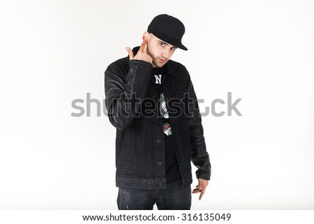 Fashion portrait of young handsome man.Cool rap dj,electro house music,deep house,mens fashion style,black style,leather jacket,rap,cat,b-boy,freestyler,dancer of a crew,singer,talented rap singer. - stock photo