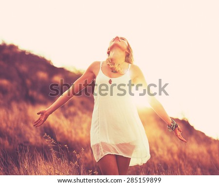 Fashion Portrait of Young Hipster Woman at Sunset, Retro Style Color Tones - stock photo