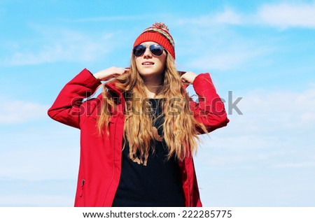 Fashion portrait of young hipster woman with hat and sunglasses on the beach. Photo toned style Instagram filters. - stock photo