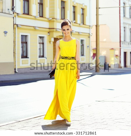 Fashion portrait of young magnificent woman. Elegant girl posing outdoor - stock photo
