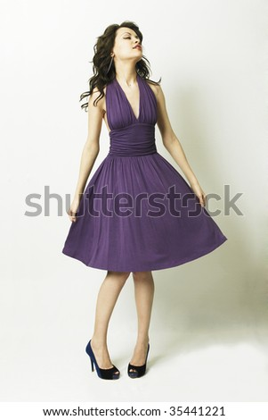 Fashion portrait of young magnificent woman in elegant dress - stock photo