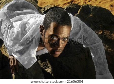 Fashion portrait of young male model in desert - stock photo
