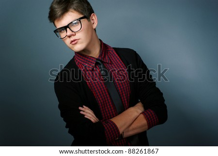 Fashion portrait of young man with glasses