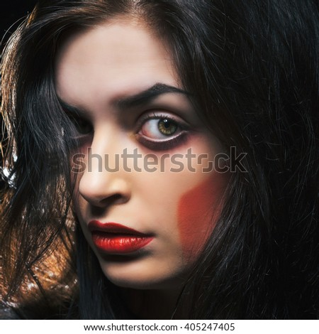 Fashion portrait of young passionate model. Woman with makeup in red colors. Studio shot. - stock photo