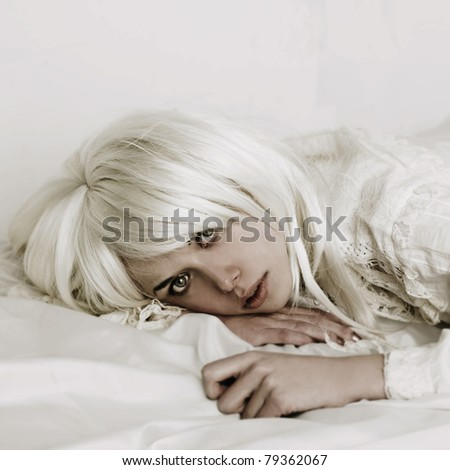 Fashion portrait of young seductive woman in bed - stock photo