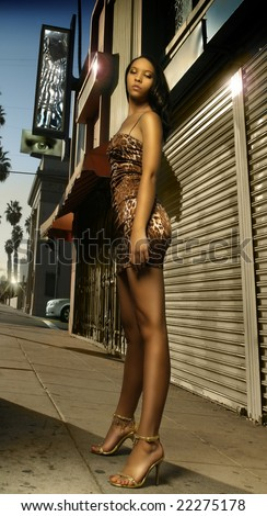 Fashion portrait of young sexy African-American female model on street - stock photo