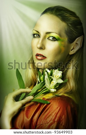 Fashion portrait of young sexy woman with creative green spring or summer make-up - stock photo