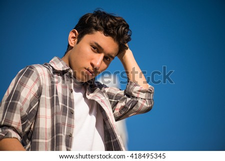 Fashion portrait of young thinking and serious man, a bit rebellious  - stock photo