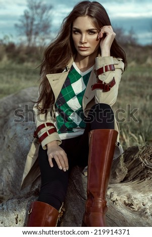 Fashion portrait of young woman outdoor in autumn scenery - stock photo