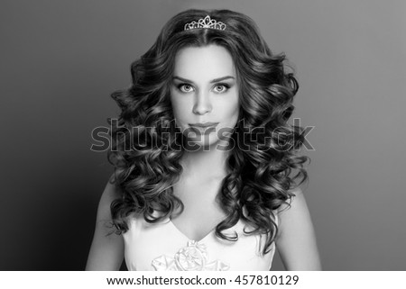 Fashion portrait of young woman with magnificent curly hair. Perfect make-up. Bride .Wedding style. - stock photo