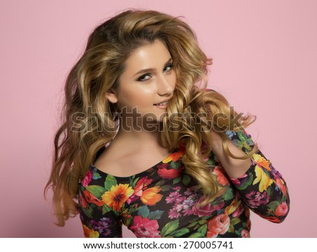 Fashion portrait of young woman with magnificent hair. Blonde girl. Perfect make-up - stock photo
