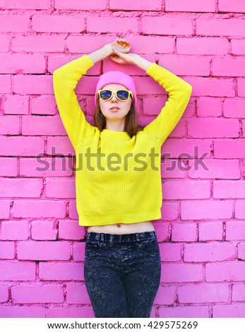 Fashion portrait pretty woman over colorful pink background - stock photo