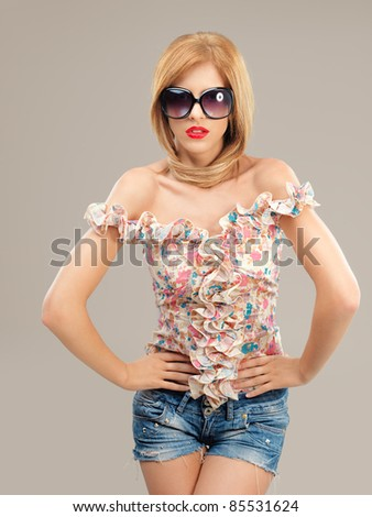 fashion portrait sexy woman sunglasses, jeans shorts posing - stock photo