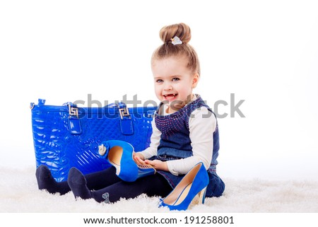 fashion portrait. Stylish little girl with shoes and bag mom. isolated on white background. fashionista, shopping