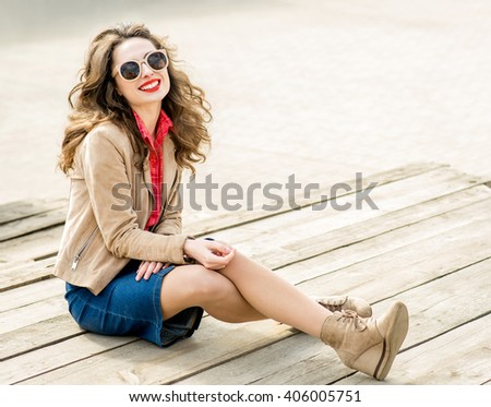 Fashion portrait stylish pretty woman in sunglasses outdoor. Young smiling woman. Street fashion. Red lipstick. - stock photo