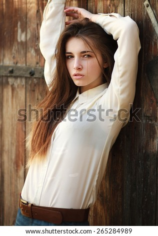 Fashion portrait stylish urban girl posing in the old city street  - stock photo
