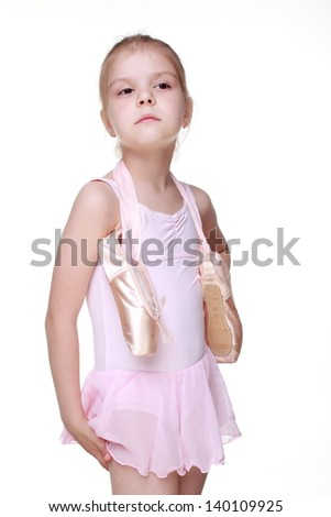 Fashion pretty young ballerina with  points