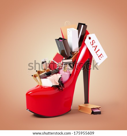Fashion purchases into a woman's shoe. Sale - stock photo