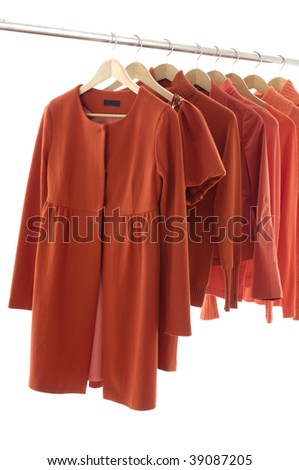 Fashion red female clothes on Hangers - stock photo