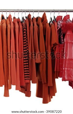 Fashion red female jacket on hangers - stock photo