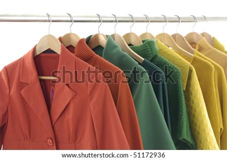 Fashion red female jacket on hangers - stock photo