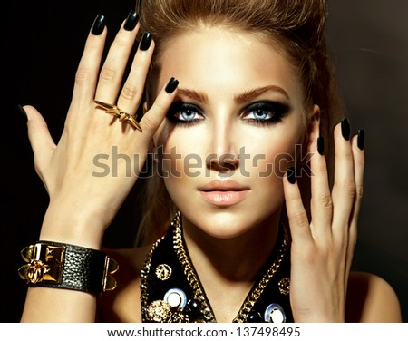 Fashion Rocker Style Model Girl Portrait. Hairstyle. Rocker or Punk Woman Makeup and Hairdo - stock photo