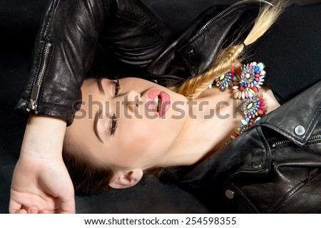 Fashion Rocker Style Model Girl Portrait. Hairstyle. Rocker Woman Makeup and Hairdo - stock photo