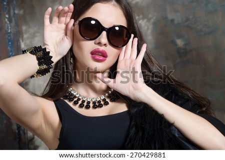 Fashion Rocker Style Model Girl Portrait. Hairstyle. Rocker Woman Makeup and Hairdo