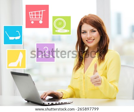 fashion, sale, people and technology concept - smiling woman with laptop computer shopping online and showing thumbs up at home - stock photo