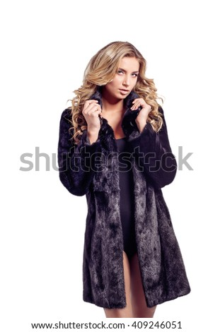 Fashion seductive blond hair lady in an elegant fur coat and black underwear on white, isolated. Retouched. - stock photo