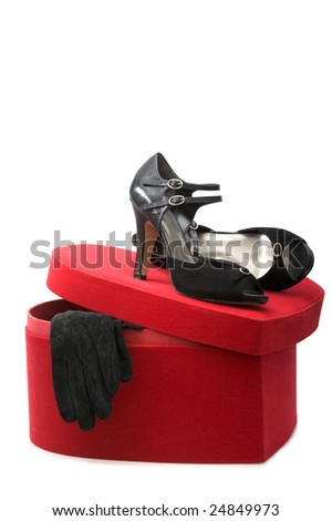 Fashion series: woman's black shoes and black glove on the heart box - stock photo
