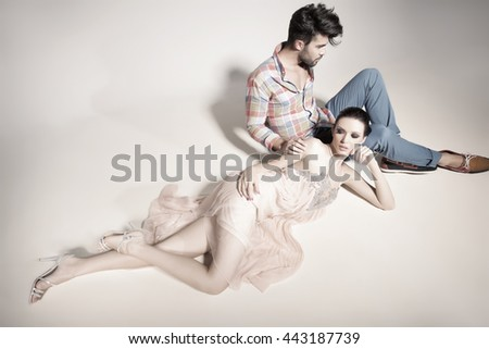 fashion sexy couple dressed elegant posing in the studio