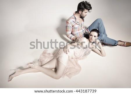fashion sexy couple dressed elegant posing in the studio  - stock photo
