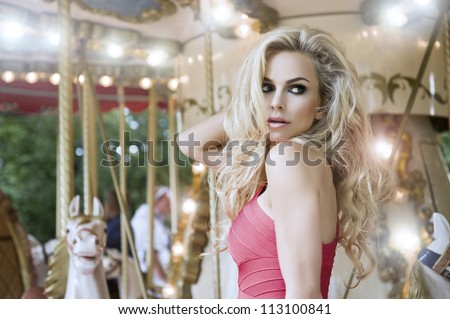 Fashion sexy model posing on carousel