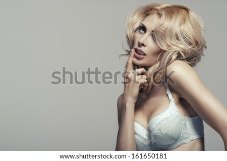 Fashion sexy shoot of young sexy woman in lingerie - stock photo