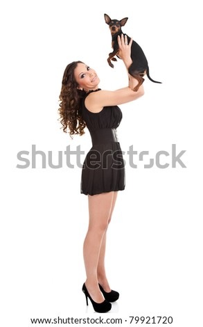 fashion,  sexy, woman playing with her miniature pinscher - stock photo