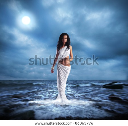 Fashion shoot of Aphrodite styled young woman - stock photo