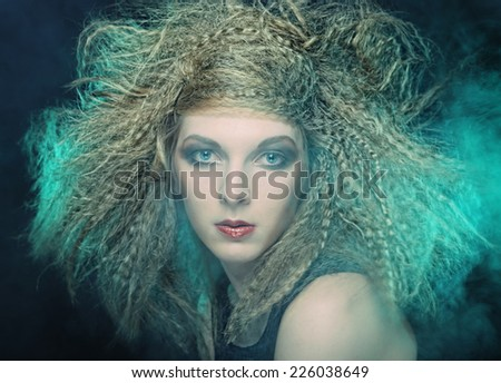 Fashion shoot of young and sexy woman in smoke  - stock photo