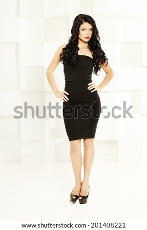 Fashion shoot of young gorgeous woman with beautiful hair - stock photo