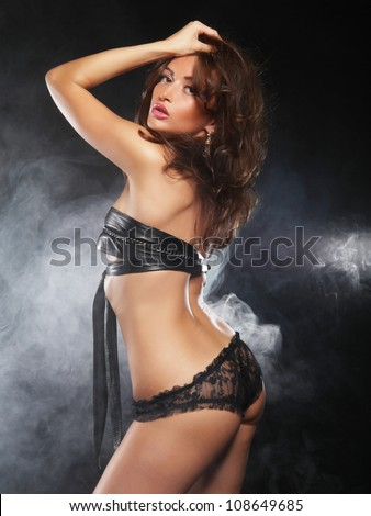 Fashion shoot of young sexy striptease dancer - stock photo